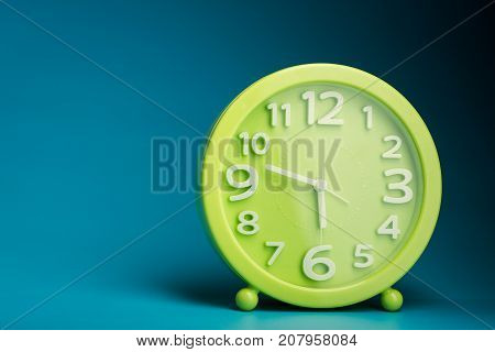 Green Time Clock With White Numbers