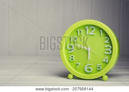 Time Clock On Wood Kithen Table