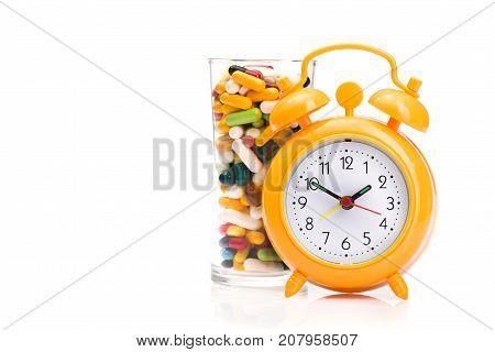 Orange Alarm Clock And Medical Pills