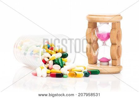 Concept Of Medical Pills And Hourglass