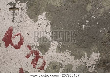Old crumbling paint on gray plaster concrete wall texture