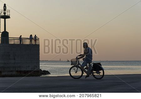 Rimini Italy - July 31 2017: People on the pier at the sunset