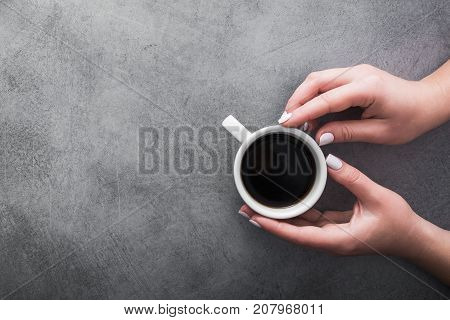 Woman In Warm Sweater Holds A White Cup Of Coffee