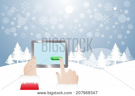 View of finger of Santa Claus touching green button Subscribe in tablet. Winter snowy landscape is in the background.