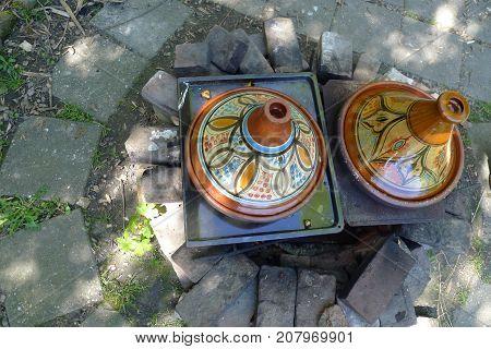 Cooking a oriental meal in the Tajin in the garden
