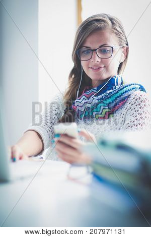 Woman use of mobile phone in university. Student. University