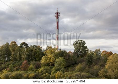 Antenna and cell phone towers on a mountaintop on a clear dayin autumn.