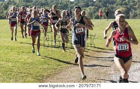 Wappingers falls New York USA - 23 September 2017: The lead pack of the varsity high school girls cross country race at the Bowdoin Park Cross Country Invitational around 400 meters into the 5K race.