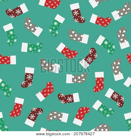 seamless pattern with christmas socks colored christmas socks for gifts on a blue background pattern