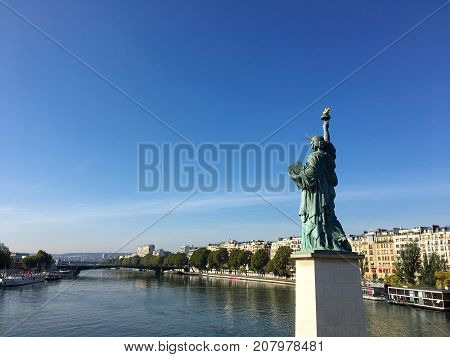 View on Statue of liberty and Seine river on ile aux cygnes swan island Paris France