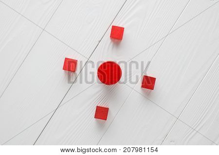 Target concept.Red wooden blocks on white wooden background top view. Abstract background. Concept of creative logical thinking. Different geometric shapes wooden blocks on wooden background flat lay.