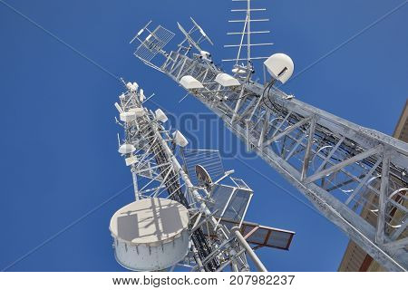 Communication transmitter tower against clear blue sky