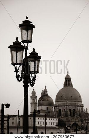 Street lamp Santa Maria della Salute church in Venice, Italy.