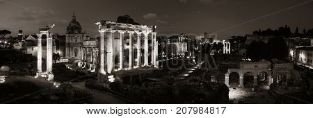 Rome Forum with ruins of ancient architecture at night panorama. Italy.