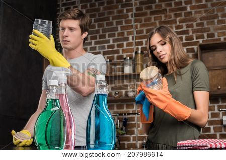 Couple Cleaning Glass Jars
