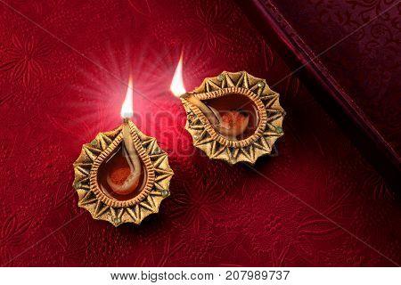 Beautiful Lit Golden Diwali Diya Lamp Lights
