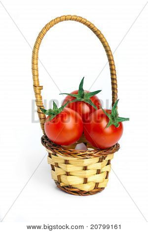 Small basket and three tomatoes cherries