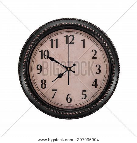 Ancient wall clock on a white background. Ten minutes to eight on the clock.