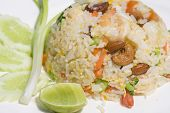delicious seafood fried rice with shrimp crab eggs and a light garnishing of spring onions. poster