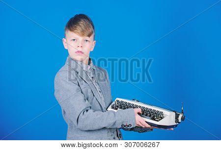 Vintage Typography. Cute Boy Having Typing Machine. Small Kid With Vintage Typewriter. Smart Child U