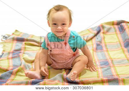 Cheerful And Carefree. Happy Little Child. Adorable Small Baby. Little Boy Child. Cute Baby Sit On F