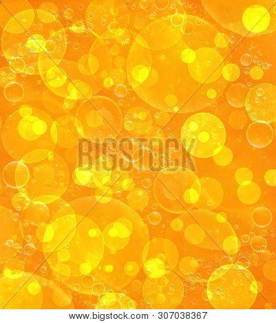 Orange Defocused Bokeh Pattern Wallpaper. Abstract Blurred Background.