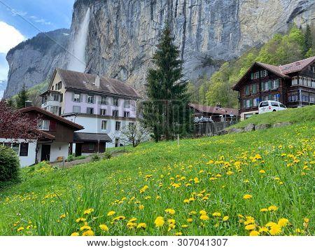 Waterfalls and cottages in Lauterbrunnen, Switzerland