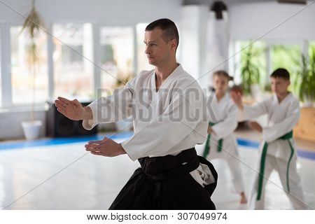 Young Experienced Aikido Trainer Showing His Pupils Movements