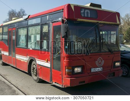 Kazakhstan, Ust-kamenogorsk, April 23, 2019: Scania Cn113. Red Old Bus On One Of The City Streets. O