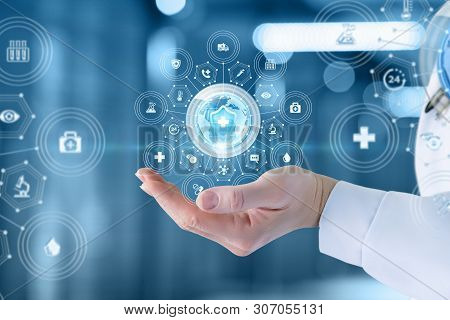 The Concept Of Health Protection In The Whole World. The Doctor Shows The Icon Of The Protection Of