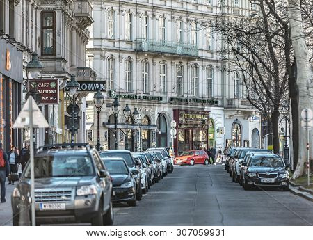 Viena, Austria - March 18, 2019: Urban View Of The Austrian Street With Cars And Shops