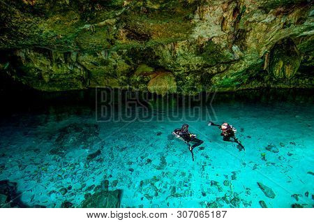 Cenote Dos Ojos - Cave Two Eyes - In Mexico, Peninsula Yucatan With Sparkling Clear Blue Water And W