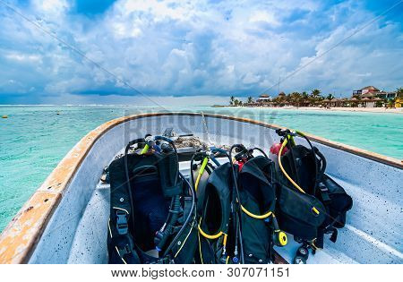 Boat With Scuba Diving Equipment Heading For Dive In Paradise, Mahahual, Yucatan, Mexico