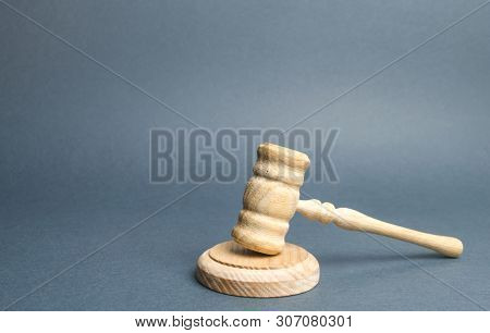Judge's Hammer On A Gray Background. The Judicial System. Norms, Rules And Laws. Conflict Resolution