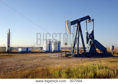 oil well and storage tanks in the texas panhandle. poster