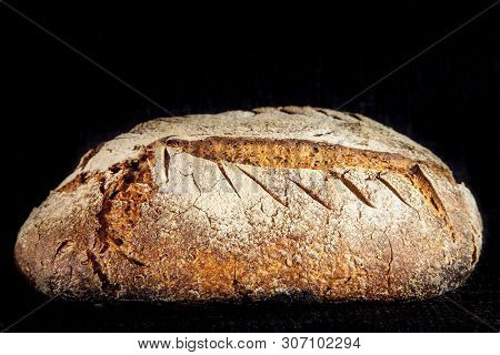 Loaf (or Miche) Of French Sourdough, Called As Well As Pain De Campagne, On Display On A Black Backg