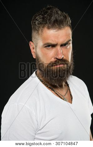 Hair Design Trends. Serious Hipster With Long Beard And Stylish Hair On Black Background. Bearded Ma