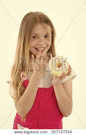 Treats for holidays. Kid rewarded for good behavior with sugary treats. Girl cute smiling face holds sweet donut. Girl likes sweets as donuts. How tame childs sweet tooth. Treats and dieting concept. poster