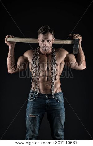 Hes a workman. Worker on black background. Hard worker holding hammer in strong hands. Construction worker or constructor showing fit torso with six pack abs. Man worker or craftsman, vintage filter. poster