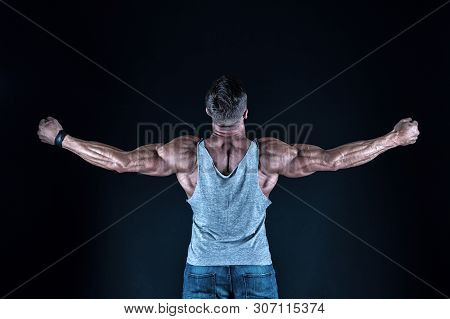 Dare To Be Great. Fit Man Back View. Fit Athlete Showing Muscular Power On Black Background. Strong