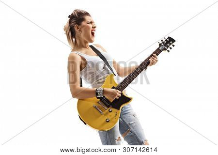 Young punk musician singing and playing an electric guitar isolated on white background