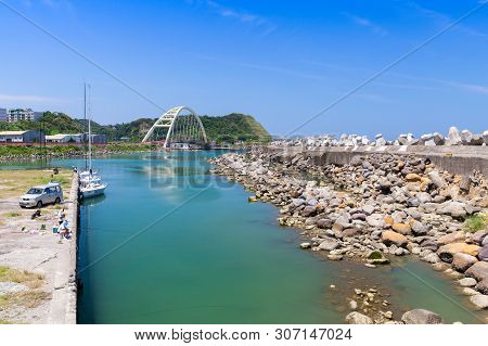 Keelung, Taiwan - September 6, 2018: Coastal Landscape Of Keelung City With Fishermen Near Massive C