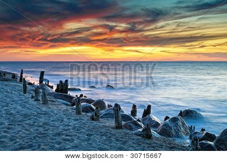 Sunset on shore of the Baltic Sea. poster