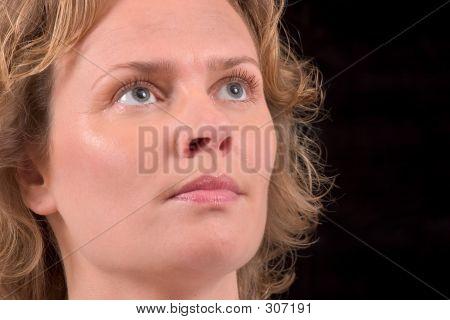 Pretty Blond Woman On Black