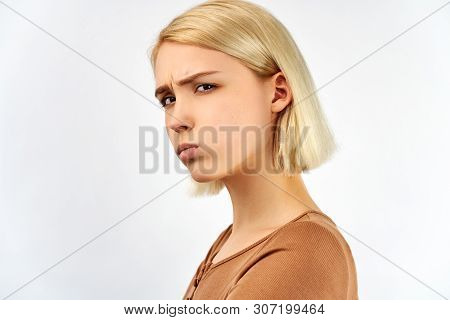 Negative Emotions And Offence. Portrait Angry Woman With Blond Hair. Emotive Abused Female With Sorr
