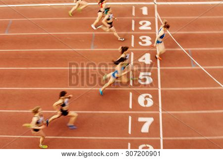 Finish Line Woman Runners Sprinters Run 100 Meters Motion Blur
