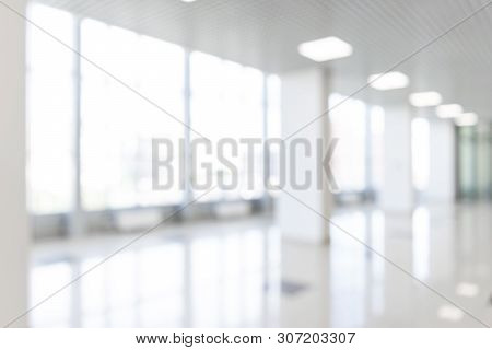 Blurred Defocused Bokeh Background Of Exhibition Hall Or Convention Center Hallway. Business Trade S