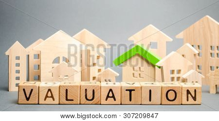 Wooden Blocks With The Word Valuation And Many Houses. Resale Residential Property Condition. The St