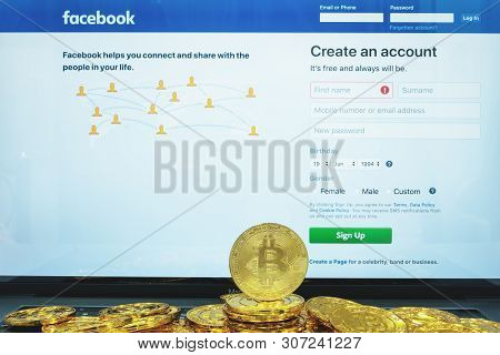Chiang Mai,thailand - June 19,2019: Facebook App And Bitcoin Cryptocurrency Fb Libra Coins Concept.