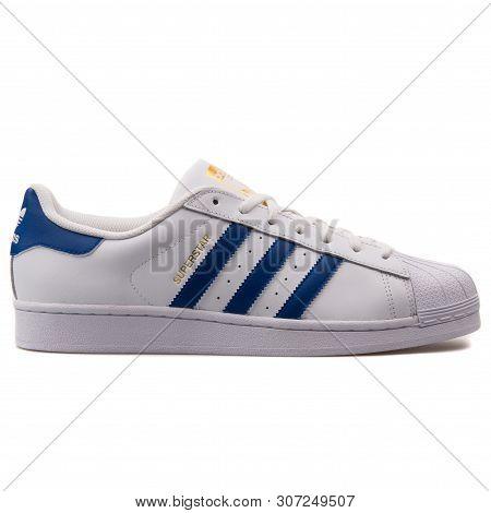 Vienna, Austria - August 25, 2017: Adidas Superstar Foundation White And Blue Sneaker On White Backg